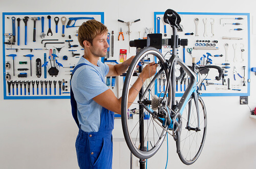bike mechanic in workshop